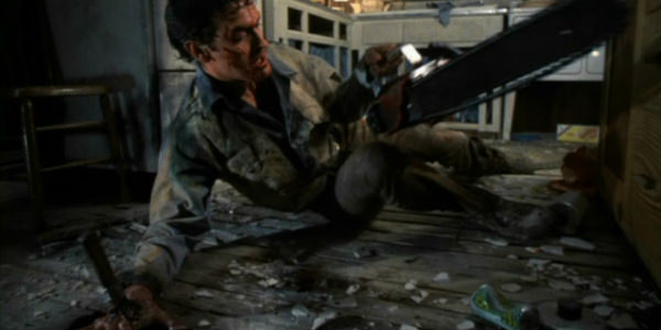 evil-dead-2-ash-cuts-his-hand-off