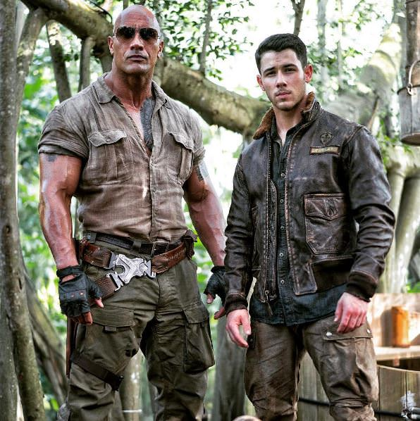 Nick Jonas and  Dwayne Johnson in Jumanji