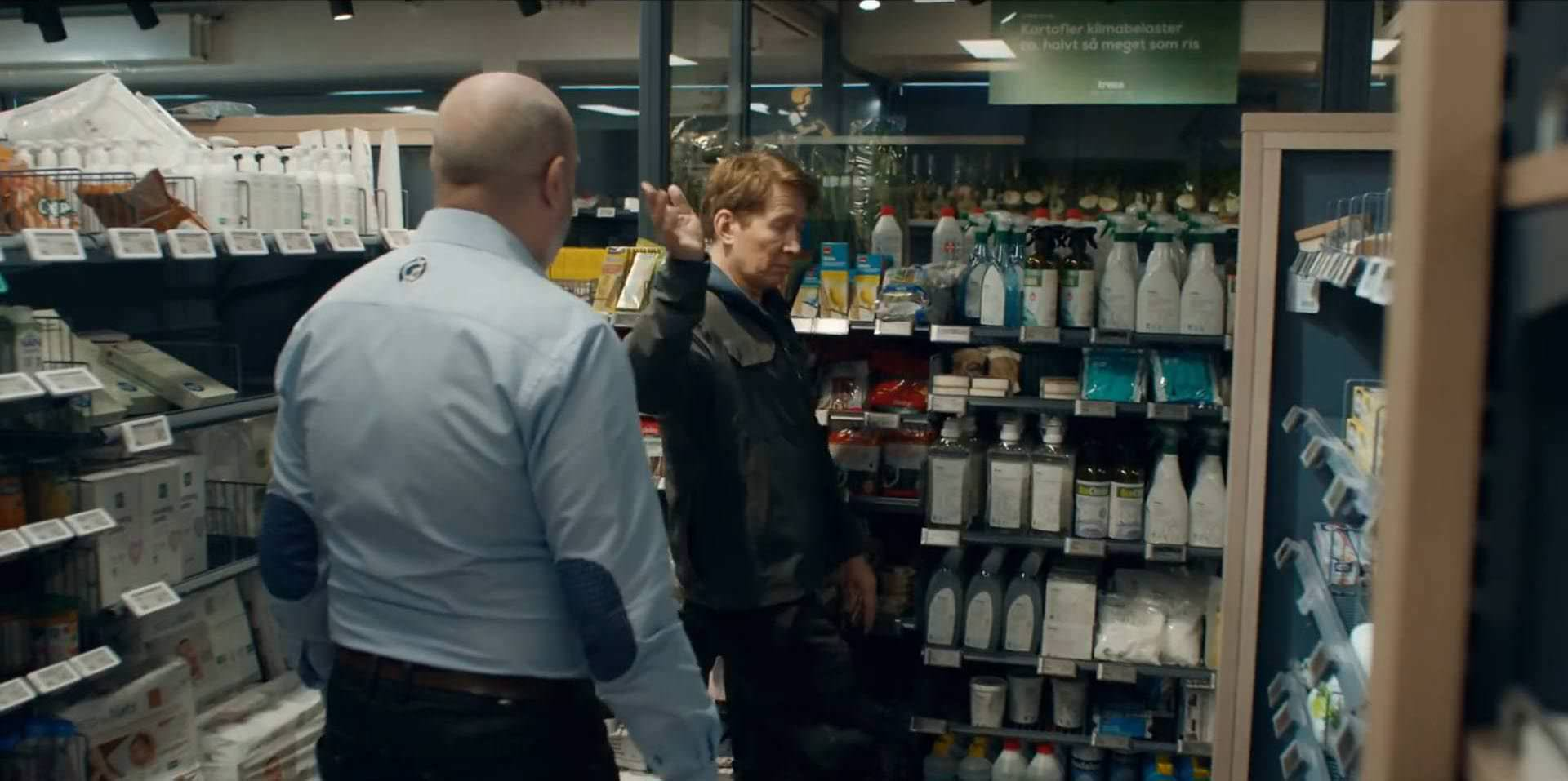 Tommy in the store with an unfavorable mood in the movie another round