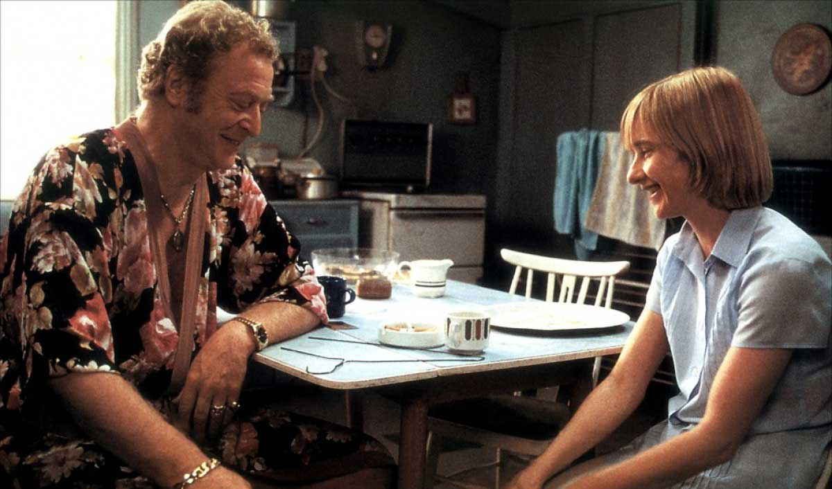 Michael Kane smiling at the breakfast table in the movie Little Voice