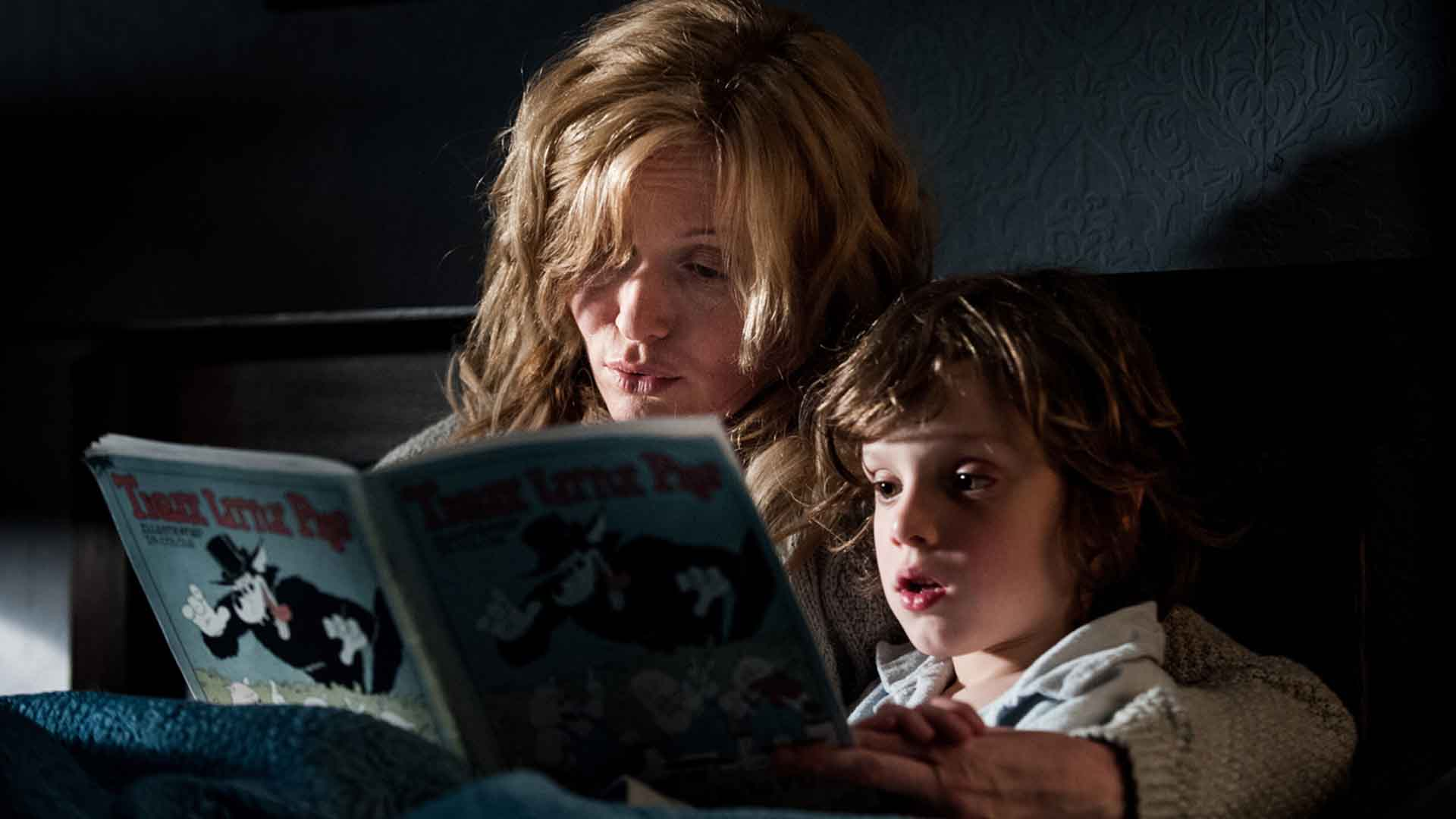Elsie Davis and Noah Wiseman reading a book in The Babadook