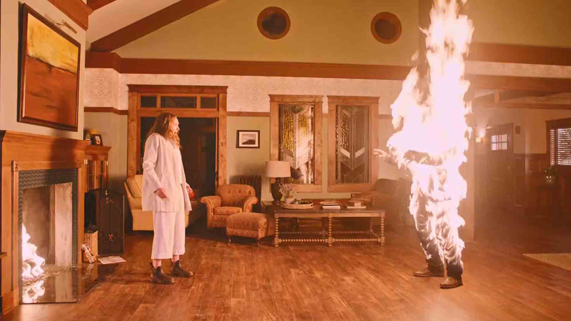 Tony Colt with a man on fire in the movie Hereditary