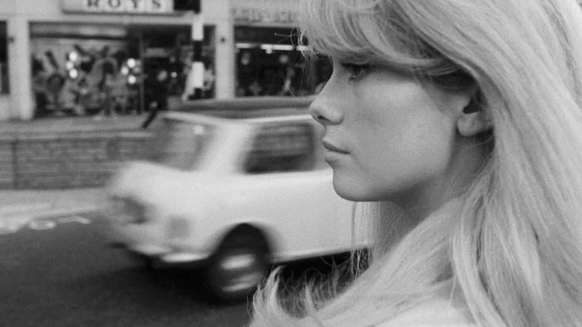Catherine Deno is looking down the street in the black-and-white version of the movie Repulsion