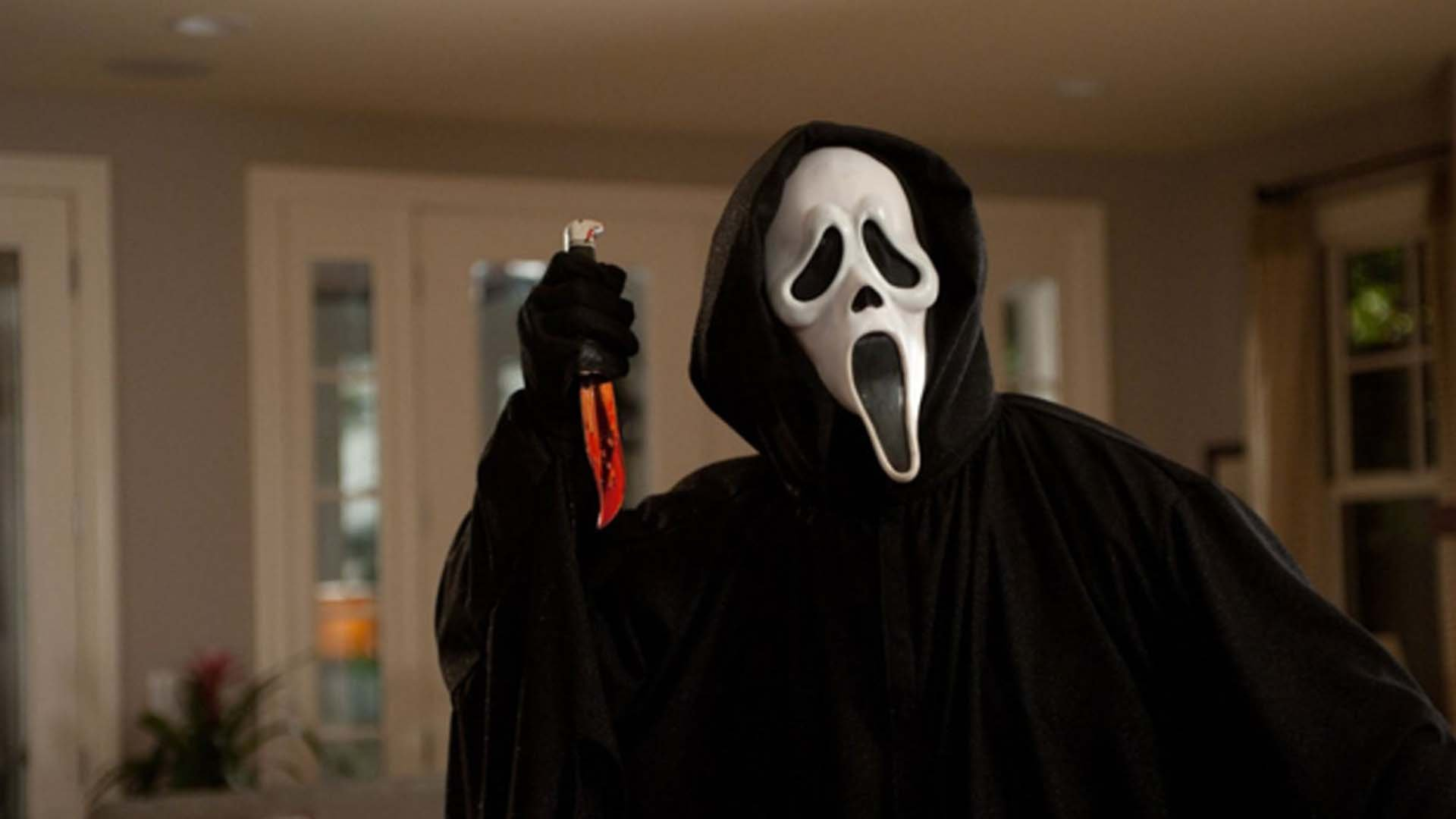 Ghost Face character with a knife in Scream