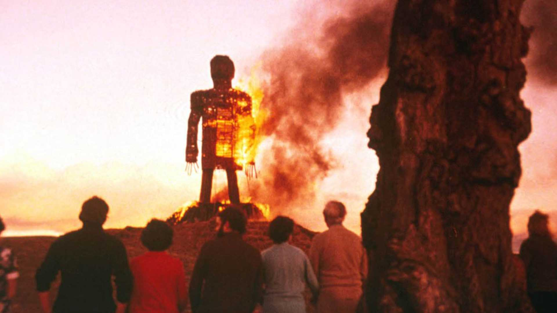 A straw man burning in front of people in The Wicker Man